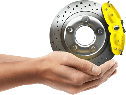 Hands holding disc brake with yellow caliper